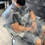 Disposable cape for hairdresser